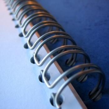 Double loop wire spiral created with the Rhin-O-Tuff Spiral book binding Machine.